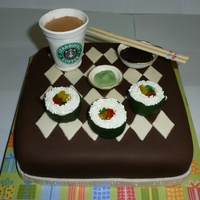 Sushi And Starbucks Caramel cake with chocolate frosting, covered in fondant with fondant/gumpaste decorations.