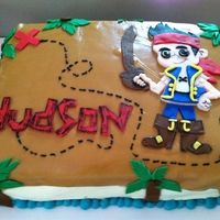 Jake And The Neverland Pirates Yellow cake, buttercream with fondant accents.