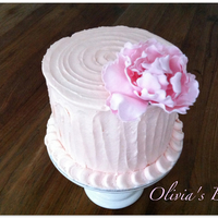 Peony Buttercream Cake 4 Layer Caramel Cake inside; rose Swiss Merengue Butter Creme with a SugarFlower outside;