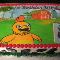 Chica (From Sprout Channel) 1St Birthday Cake Cake for a friend's daughter. She provided the pre-made cake topper sheet w/ photo and I designed the rest of the cake decoration to...