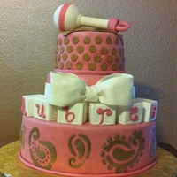 Pink And Brown Baby Shower Cake! This is a special request baby shower cake that I made for a friend! everything is edible except for rattle handle.. block and bow are made...