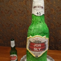 "Large Beer Bottle Cake  Sloppy/crooked ""quick""cake for a stella beer fan's 40th bday. No time to do the label by hand and had some disasters with..."