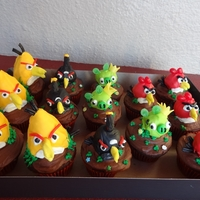 Angry Birds Cupcakes- No Fondant  Angry birds cupcakes decorated without fondant for taste pref. Round birds are donut holes and yellow are rice krispie treats. decorated...