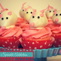 Cute Lil Mice Hanging Out On Some Pink Buttercream! Strawberry Cupcakes topped with white chocolate covered strawberries