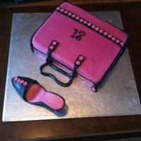 Shoe And Handbag Cake This is my first attempt at a shoe and a handbag. Unfortunately, the shoe didn't survive the delivery journey and was in 3 pieces by...