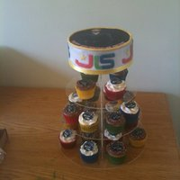 Jls Birthday Cake Chocolate top cake with vanilla and chocolate cupcakes with JLS toppers.