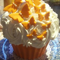 Large Cupcake   strawberry cake with buttercream and the bottom is orange chocolate