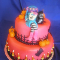 Zombie Cake Zombie girl with cat, pumpkins, bats and candy corn fence..... my first figurine cake :)