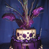 Happy Birthday Purple and white with a tier of purple and zebra. Lots of sparkle feathers and toppers