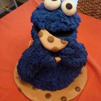 Cookie Monster Cake Cookie Monster cake. 3 tiers, bottom 2 choc mud top tier was marble cake. Head was rice krispie treats covered in fondant. Fur was made out...