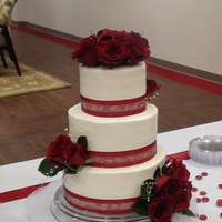 Red Rose Wedding Cake iced in BC with ribbon and fresh roses