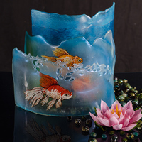 Goldfish Trio Sculpture This was my first-ever competition entry - done for 2013 That Takes The Cake. Awarded Best of Division: Professional Free-standing isomalt...