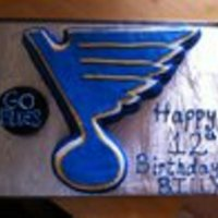 Blues Note Cake Blues Note and puck are both chocolate cake with buttercream covered in fondant.