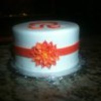 "Wedding Shower 10"" White cake with buttercream covered in fondant. Orange fondant ribbon, flower, and letter ""R. Thank you awatterson for your..."
