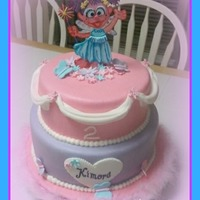 Abby Cadabby Abby Cadabby cake for a two year old. French Vanilla cake with vanilla buttercream covered in buttercream flavored fondant. Abby was cut...