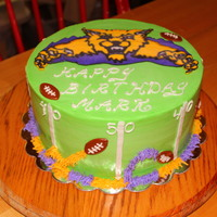 Western Carolina Catamounts! Chocolate cake, BC, royal icing catamount transfer, fondant footballs.