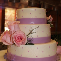 Pink And Lavender Bliss   Butter cream with fondant accents and fresh roses