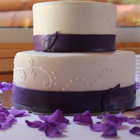 Plum Elegance   buttercream with fondant ribbon.
