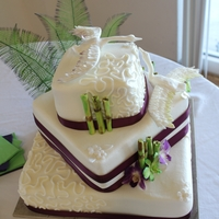 Cranes, Bamboo And Orchids!  Bottom tier: white cake/strawberry filing, 2nd tier: Lemon cake/raspberry filling and top tier is white cake with buttercream icing....