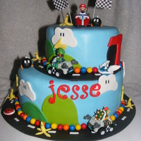 Mario Kart For Jesse!  WASC cake with SMBC. All edible, except karts and flags. Unfortunately, the pre-made letters of his name were attacked by my toddler, so...