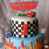 Cars Birthday Cake!   Thanks to mrsmudrash for the flame template! Though mine isn't as neat as hers :)
