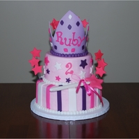 Birthday Cake Fit For A Princess Buttercream cake with fondant accents.