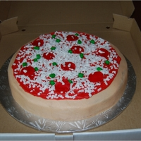 Pizza Cake Buttercream pizza cake with fondant accents.