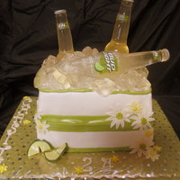 Bud Light Lime Beer Cake For Female This is a 1/2 Butter Cream (bottom) and Fondant (Top) made to look like a container filled with ice and Bud Light Lime beer. The bottles...