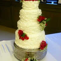Branch Texture 4 Tiered Wedding Cake This 4 tiered wedding cake is Italian Cream with Almond Butter cream.
