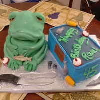 "Fishing Frog is all Cake frosted with buttercream and covered in MMF. Details are in Gumpaste. ""Tackle"" box is all cake, vanilla cake,..."