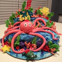 "8 ""legs"" Under The Sea This is a 2 tier cake with an octopus sitting center stage! Lots of royal icing and fondant coral and sea weed to enhance the underwater..."