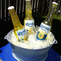 Coronas In A Bucket Made a mold using rubber paint. Bottles and ice made using isomalt. Labels were printed on paper the rest is chocolate cake, ganache and...