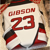Hockey Jersey Cake Chocolate cake covered in fondant. Name and numbers cut using my Cricut Cake.