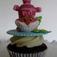 Cheshire Cat Red velvet cupcake with gumpaste Cheshire cat topper.