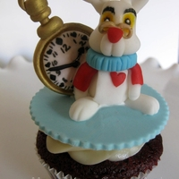 White Rabbit Red velvet cupcake with gumpaste sculpted White Rabbit & pocket watch topper.