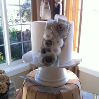 1322427922.jpg Bride & Groom cut cake. Fondant covered with rice paper rose accents and peg people topper