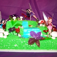 Fairy Cake 6th birthday, fairy cake. Bottom layer is chocolate with chocolate ganache filling, top two layers are white cake with strawberry filling,...