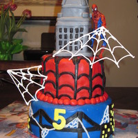 Spiderman Birthday Cake This is my son's 5th birthday cake. The cake is fudge marble with chocolate chocolate chip filling, covered in MMF. The building is...