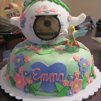 Tinkerbell Birthday Cake This was inspired by the Wilton Teapot cake. I included lots of pink and purple flowers for my little girl who loves pink and purple. The...