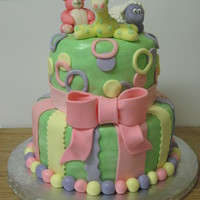 Stuffed Animal Baby Shower This was a cake for a baby shower. The cake was lemon with keylime buttercream and lemon curd filling, covered in MMF with MMF accents. The...