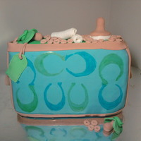 Coach Baby Bag   Baby bag with baby items and over flowing with cheerios