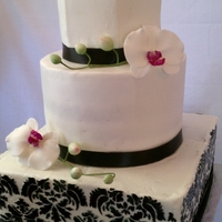 Black And White Demask Buttercream Cake   Buttercream cake with demask pattern decorated with calla lilies and moth orchids.