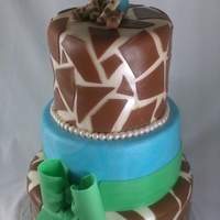 Giraffe Baby Shower Cake Blue and green giraffe baby shower cake.
