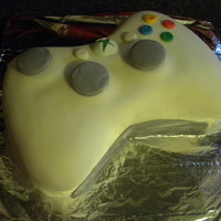 X-Box 360 Controller Birthday Cake I made this fairly recently for a cousin of mine. This one was super fun!!! White cake, vanilla buttercream filling, MMFondant