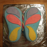 Butterfly Cake A simple little butterfly cake for a friend's birthday. I used a tootie fruity candy cane for the body.