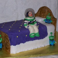 Buzz Lightyear Made for a 3 year old birthday, Buzz is made from modeling chocolate and the helmet is made of gelatin.