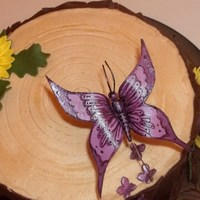 Tree Stump Cake Red Velvet Cake w/ PB Buttercream per customer's request w/ chocolate mmf for the bark. The butterfly is made of gumpaste and...