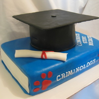 "Graduation Cake Recipient received his Bachelor's degree in Criminology. Criminology Book with bulldog (school mascot) paw prints. 6"" graduation..."
