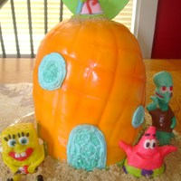 Spongebob Squarepants pineapple cake, covered in fondant, and airbrushed. figures are made out of fondant/gumpaste.