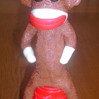 Sock Monkey Figure Sock monkey, I made for a friend, she made the cake,, but knew she couldnt make the figure.. so i got too..